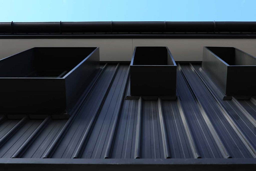 Metal wall cladding on a school building in Wyoming, north of Sydney NSW