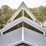 Custom design details on metal roofing on a large church in Kenthurst NSW